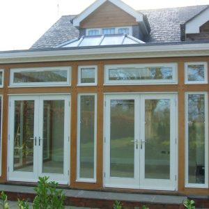 095 - Conservatory with double French doors and dental mould detail