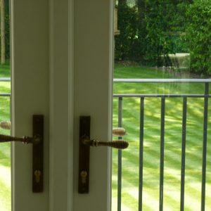 172 - Up close of ironmongery on French doors in an antique brass colour
